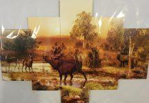 Több részes kép szarvasokkal erdőben